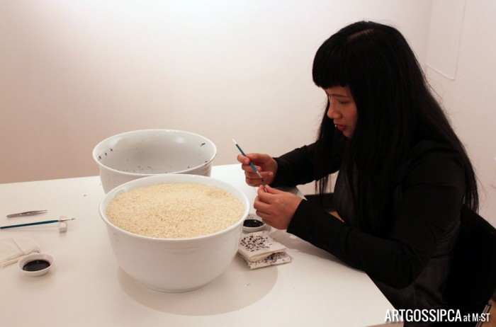 Chun Hua Catherine Dong painting rice black at Untitled Arts Society's Satellite Gallery