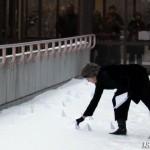 Sandra Vida plants tiny pyramidal mountains in the snow at the University of Calgary.