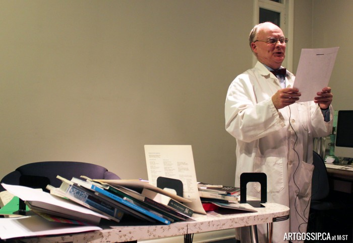 """Andy Paterson reading a poem, signed by one """"K. Burns"""", found in the New Gallery's archives at John Snow House."""