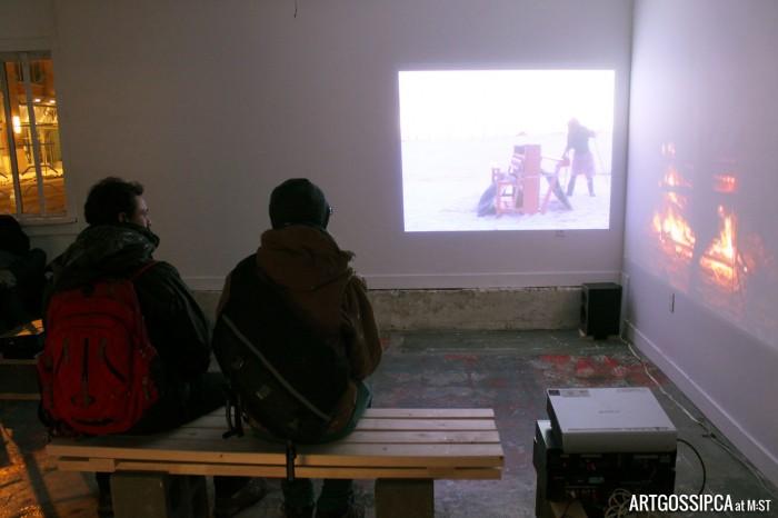 Eduardo Oramas & David Frankovich watch Lupypciw set fire to her loom.